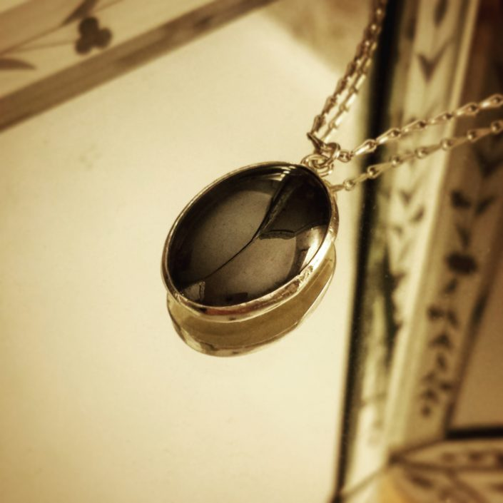 photograph of oval haematite pendant